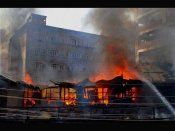 China hotel fire: Several feared trapped