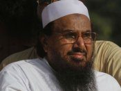 India hits back at JuD chief, says Hafiz trying to hide behind ballot