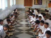 Is making Aadhar mandatory for midday meal scheme violative of SC directive?