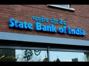 May have to undertake write-offs post merger: SBI