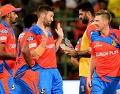 Gujrat Lions Andrew Tye Celebrates The Wicket Of Chris Gayle During The IPL 10 Match Against RCB