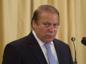Nawaz Sharif returns to Pakistan from UK to face trial