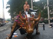 As US resents Trump, 'Vladimir Putin' rides NY Charging Bull with sex toys stuck all over it