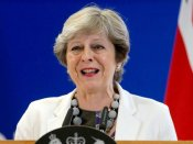 May just about survives pro-EU Tories' rebellion; threatens with poll