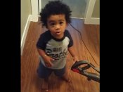 Toddler refuses to let do its mom household cleaning-up job; makes strong argument