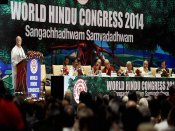 Two ladoos with a 'unity' message distributed at World Hindu Congress 2018