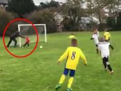 Funny video: Dad pushes distracted little goalkeeper son over to save goal