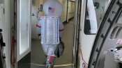 Man wears astronaut outfit to protect against coronavirus while taking flight in Beijing