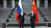 In show of unity against EU, China, Russia officials meet