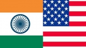 India hits out at Kerry for terming it a 'challenge' at Paris