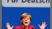 Merkel slams Trump while asserting Germany's commitment to climate accord