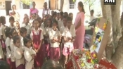 In front of a picture of 'little' Sridevi, students from actress' hometown Sivakasi pay tribute