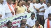 BJP stages protest against Gundu Rao's '<i>Dhongi</i>' remark on Yogi