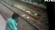 CCTV live records rescue of man who lied down on tracks to commit suicide