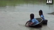 Kids travel on aluminium containers daily to reach school in this Assam village