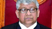 TB Radhakrishnan takes charge as first Chief Justice of Telangana HC