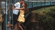 Portuguese traveller couple takes romantic photo hanging outside train
