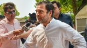 Rahul adamant even as 'sangharsh karo' slogans rent the air near his residence
