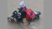 Video of Zomato delivery boy who got stuck in Vadodara rain goes viral