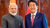PM Modi meets Japanese PM Shinzo Abe in Russia