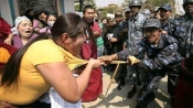 Fake image of an Indian Army Jawan pulling top of a female anti-CAA protester in Assam goes viral