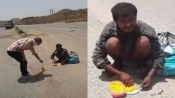 Heart-wrenching video of starving man eating 'dog' carcass goes viral