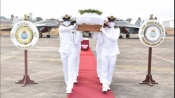 Fighter pilot killed in crash laid to rest with full military honours