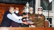 Rajnath Singh hands over best marching contingent trophies to Jat Regimental Centre, Delhi Police
