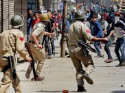 Indian Army in Kashmir fighting people shouting 'go back Indian dogs' slogan