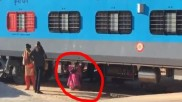 Commuters slide under the train at Whitefield to cross the track, see the video