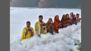 In Pics: Chhath puja amid toxic foams on Yamuna bank