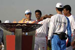 Paes-Bhupati together holding Olympic Torch