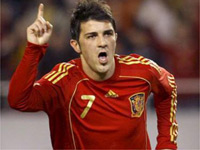Villa brings Spain back on track