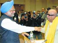 Karunanidhi and Manmohan Singh