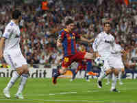Lionel Messi of Barcelona kicks the opening goal
