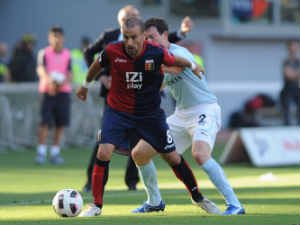 Rodrigo Palacio of Genoa CFC is challenged by Stephan Lichtsteiner of SS Lazio