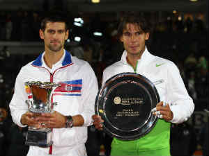 Novak Djokovic of Serbia holds the trophy after his victory in the final against Rafael Nadal of Spain during day eight of the Internazoinali BNL D'Italia at the Foro Italico
