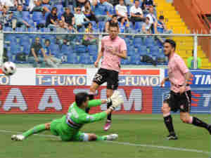 Mauricio Pinilla (R) of Palermo scores his team's second goal during the Serie A match