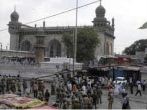 Police forces deployed at the site of bomb blast at Mecca Masjid
