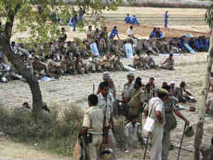 Police forces deployed in Uttar Pradesh to prevent possible untoward incidents during farmers' protest in Uttar Pradesh, over the land acquisition.