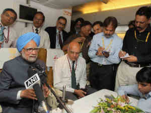 Prime Minister Manmohan Singh addresses a press conference on board his special aircraft