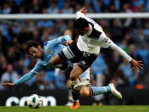Sandro of Tottenham Hotspur competes with David Silva of Manchester City