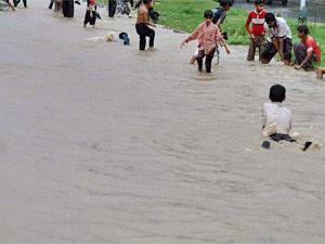 Children playing in rain water