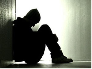 Boy sitting in dark