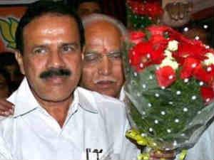 Karnataka Chief Minister Sadananda Gowda and his immediate predecessor B S Yeddyurrappa