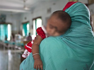A baby carried by its mother in WB hospital
