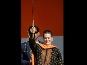 Congress president Sonia Gandhi displays a sword during an election drive in UP