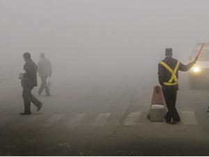 A fogged Delhi road