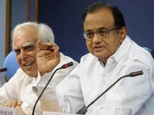 Telecom Minister Kapil Sibal with Home Minister P Chidambaram