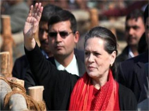 Gonda : Congress President Sonia Gandhi waves to crowd during an election rally.PTI